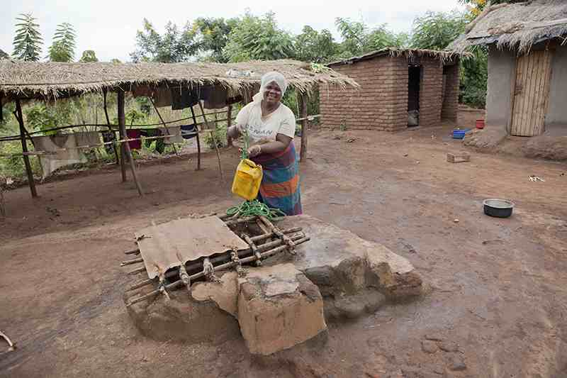 woman pulling water from well